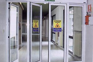 Automatic doors opening in a commercial building